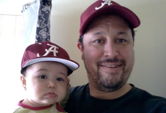 Father and daughter honing Roll Tide game face